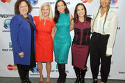 """(L-R) VP of External Relations at Clarkson University Kelly Chezum, Director of Philanthropy at the Cargil Foundation Martha """"Muffy"""" MacMillan, Women's Entrepreneurship Day Founder and CEO Wendy Diamond, NFL coach Jen Welter and singer Leona Lewis pose for a photo at the Pioneer awards Luncheon during Women's Entrepreneurship Day at the United Nations on November 19, 2015 in New York City."""