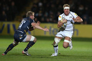 Andy Powell of Sale moves past Matt Kvesic during the Aviva Premiership match between Worcester Warriors and Sale Sharks at Sixways Stadium on October 26, 2012 in Worcester, England.