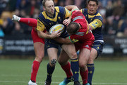 Chris Pennell of Worcester Warriors is held by Jamie Roberts during the Aviva Premiership match between Worcester Warriors and Harlequins at Sixways Stadium on April 28, 2018 in Worcester, England.
