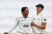 Saeed Ajmal (L) of Worcestershire celebrates with Alexei Kervezee (R) after capturing the final wicket of Monty Panesar of Essex and his seventh wicket of the innings during day three of the LV County Championship match between Worcestershire and Essex at New Road on May 20, 2014 in Worcester, England.