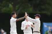 Surrey bowler Jade Dernbach (l) celebrates with Ollie Pope (r) after dismissing Worcestershire batsman Daryl Mitchell during day one of the Specsavers County Championship Division One match between Worcestershire and Surrey at New Road on September 10, 2018 in Worcester, England.
