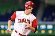 Justin Morneau #33 of Canada scores a run in the first inning during a Pool C game of the 2017 World Baseball Classic against Colombia at Miami Marlins Stadium on March 11, 2017 in Miami, Florida.