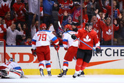 Andrei Markov #79 and Alex Ovechkin #8 of Team Russia look on as Corey Perry #24 of Team Canada celebrates his third period goal at the semifinal game during the World Cup of Hockey tournament at Air Canada Centre on September 24, 2016 in Toronto, Canada.