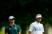 Adam Scott of Australia (L) and Bubba Watson look on from the 18th fairway during the first round of the World Golf Championships-Bridgestone Invitational at Firestone Country Club South Course on July 31, 2014 in Akron, Ohio.