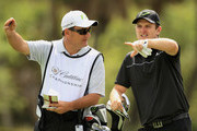 Justin Rose of England chats with his caddie Mark Fulcher on the 12th hole during the second round of the World Golf Championships-Cadillac Championship on the TPC Blue Monster at Doral Golf Resort And Spa on March 9, 2012 in Miami, Florida.