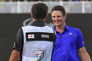 Justin Rose of England and caddie Mark Fulcher react to winning the World Golf Championship's Cadillac Championship at Doral Golf Resort And Spa on March 11, 2012 in Miami, Florida.