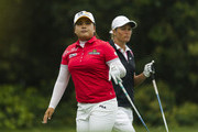 Inbee Park (L) of South Korea and Suzann Pettersen of Norway wait to play on the 6th tee during the Round 4 of the World Ladies Championship at Mission Hills' Blackstone Course on March 9, 2014 in Hainan Island, China.