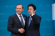Australian Prime Minister Tony Abbott greets Japan's Prime Minister Shinzo Abe during the official welcome at the Brisbane Convention and Exhibitions Centre on November 15, 2014 in Brisbane, Australia. World leaders have gathered in Brisbane for the annual G20 Summit and are expected to discuss economic growth, free trade and climate change as well as pressing issues including the situation in Ukraine and the Ebola crisis.
