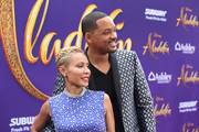 "Jada Pinkett Smith (L) and Will Smith attend the World Premiere of Disney?s ""Aladdin"" at the El Capitan Theater in Hollywood CA on May 21, 2019, in the culmination of the film?s Magic Carpet World Tour with stops in Paris, London, Berlin, Tokyo, Mexico City and Amman, Jordan."