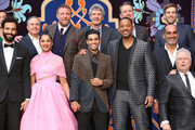 "(L-R front) Actors Marwan Kenzari, Naomi Scott, Mena Massoud, Will Smith, Navid Negahban and Composer Alan Menken . (L-R back) Walt Disney Studios President, Alan Bergman, Director Guy Ritchie, Chairman, The Walt Disney Studios, Alan Horn, President of Walt Disney Studios Motion Picture Production, Sean Bailey and producer Jonathan Eirich attend the World Premiere of Disney?s ""Aladdin"" at the El Capitan Theater in Hollywood CA on May 21, 2019, in the culmination of the film?s Magic Carpet World Tour with stops in Paris, London, Berlin, Tokyo, Mexico City and Amman, Jordan."