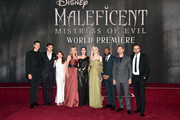 """(L-R) Actors Harris Dickinson, Sam Riley, Jenn Murray, Michelle Pfeiffer, Angelina Jolie, Elle Fanning, Chiwetel Ejiofor, Ed Skrein, and director Joachim Rønning attend the World Premiere of Disney's """"Maleficent: Mistress of Evil"""" at the El Capitan Theatre on September 30, 2019 in Hollywood, California."""