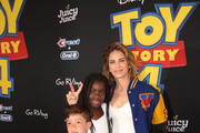 Jillian Michaels (R) and family attend the world premiere of Disney and Pixar's TOY STORY 4 at the El Capitan Theatre in Hollywood, CA on Tuesday, June 11, 2019.