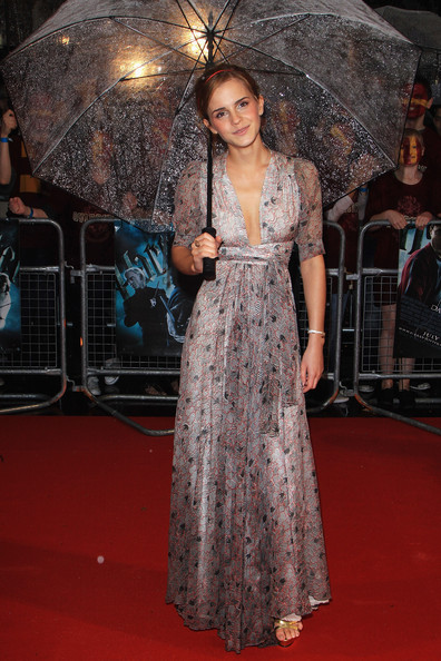 Emma Watson arrives as the rain pours down at the World Premiere of Harry Potter And The Half Blood Prince at Empire Leicester Square on July 7, 2009 in London, England.