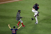 Chris Sale #41 of the Boston Red Sox is embraced by Christian Vazquez #7, David Price #24 and Joe Kelly #56 of the Boston Red Sox after their teams 5-1 win over the Los Angeles Dodgers in Game Five to win the 2018 World Series at Dodger Stadium on October 28, 2018 in Los Angeles, California.