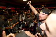 Jon Lester #34 of the Chicago Cubs is celebrates in the clubhouse after the Chicago Cubs defeated the Cleveland Indians 8-7 in Game Seven of the 2016 World Series at Progressive Field on November 2, 2016 in Cleveland, Ohio. The Cubs win their first World Series in 108 years.