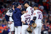 Manager A.J. Hinch #14 of the Houston Astros speaks to pitcher Charlie Morton #50 and teammates against the Los Angeles Dodgers in game four of the 2017 World Series at Minute Maid Park on October 28, 2017 in Houston, Texas.