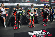 (L-R) Eugene Laverty of Ireland and Aprilia Racing Team, Tom Sykes of Great Britain and Kawasaki Racing Team and Sylvain Guintoli of France and Aprilia Racing Team pose for photographers at the end of the Superpole during the World Superbikes - Qualifying during the round four of 2013 Superbike FIM World Championship at Autodromo di Monza on May 11, 2013 in Monza, Italy.