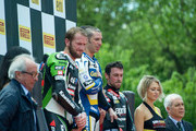 (L-R)  Tom Sykes of Great Britain and Kawasaki Racing Team, Marco Melandri of Italy and BMW Motorrad GoldBet SBK and Eugene Laverty of Ireland and Aprilia Racing Team pose on the podium at the end of round four of the 2013 Superbike FIM World Championship at Autodromo di Monza on May 12, 2013 in Monza, Italy.