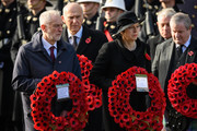 Leader of the Labour Party Jeremy Corbyn and British Prime Minister Theresa May carry their wreaths during the annual Remembrance Sunday memorial on November 11, 2018 in London, England. The armistice ending the First World War between the Allies and Germany was signed at Compiègne, France on eleventh hour of the eleventh day of the eleventh month - 11am on the 11th November 1918. This day is commemorated as Remembrance Day with special attention being paid for this year's centenary.