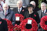 (L-R)  Leader of the Labour Party, Jeremy Corbyn, Leader of the Liberal Democrats, Vince Cable, British Prime Minister, Theresa May and Leader of the Scottish National Party Ian Blackford .hold wreaths during the annual Remembrance Sunday memorial on November 11, 2018 in London, England. The armistice ending the First World War between the Allies and Germany was signed at Compiègne, France on eleventh hour of the eleventh day of the eleventh month - 11am on the 11th November 1918. This day is commemorated as Remembrance Day with special attention being paid for this year's centenary.