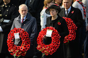 Leader of the Labour Party Jeremy Corbyn and British Prime Minister Theresa May hold their wreaths during the annual Remembrance Sunday memorial at the Cenotaph on Whitehall on November 11, 2018 in London, England. The armistice ending the First World War between the Allies and Germany was signed at Compiègne, France on eleventh hour of the eleventh day of the eleventh month - 11am on the 11th November 1918. This day is commemorated as Remembrance Day with special attention being paid for this year's centenary.