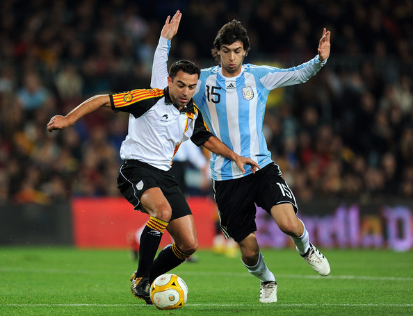 Xavi Hernandez and Javier Pastore - Catalunya v Argentina: International Friendly