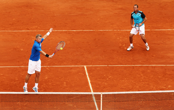 2012 French Open - Day Eight [tennis player,sports,tennis court,sport venue,tennis,tennis racket,soft tennis,racket,racquet sport,tennis equipment,mark knowles,men,bob bryan,mike bryan,2012 french open,doubles,action,bahamas,l,match]