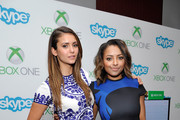 'The Vampire Diaries' actresses Nina Dobrev (L) and Kat Graham chat with fans over Skype for Xbox One in the Microsoft VIP Lounge during Comic-Con on July 26, 2014 in San Diego, California.