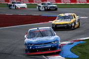 Elliott Sadler, driver of the #1 OneMain Financial Chevrolet, races during the NASCAR XFINITY Series Drive for the Cure 200 at Charlotte Motor Speedway on September 29, 2018 in Charlotte, North Carolina.
