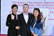 Actress Xu Fan, director Feng Xiaogang and actress Siyu Feng attend a ceremony immortalizing director Feng Xiaogang with a hand and footprint at TCL Chinese Theatre IMAX on November 1, 2013 in Hollywood, California.