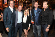 Valeri Bure and Candace Cameron-Bure pose with Yardbird founder John Kunkel and guests at the Yardbird Southern Table & Bar Los Angeles Grand Opening on April 5, 2018 in Los Angeles, California.