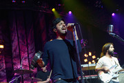 (L-R) Musicians Francois Comtois, Sameer Ghadia and Payam Doostzadeh perform onstage during the Young The Giant iHeartRadio Live show at the iHeartRadio Theater on May 14, 2014 in Burbank, California.