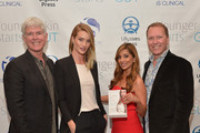 "(L-R) President and CEO iS CLINICAL Bryan Johns, Rosie Huntington-Whiteley,  author Dr. Nigma Talib and Vice President and COO iS CLINICAL Alec R. Call attend the ""Younger Skin Starts In The Gut"" book launch party at Four Seasons Hotel Los Angeles at Beverly Hills on March 22, 2016 in Los Angeles, California."