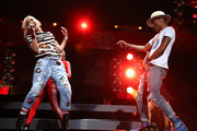 Gwen Stefani (L) and Pharrell Williams perform onstage during iHeartRadio Jingle Ball 2014, hosted by Z100 New York and presented by Goldfish Puffs at Madison Square Garden on December 12, 2014 in New York City.