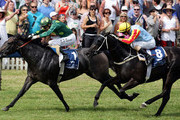 Opie Bosson riding Katie Lee wins the Cambridge Stud Eight Carat Classic race ahead of Leith Innes riding Adaline during the Zabeel Classic meeting at Ellerslie Racecourse on December 26, 2009 in Auckland, New Zealand.