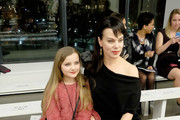 Actress Debi Mazar (R) and daughter Giulia Isabel attend the Zac Posen Fall 2016 fashion show during New York Fashion Week at Spring Studios on February 15, 2016 in New York City.