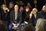 Nigel Barker and Carol Alt sit front row at the Zang Toi front row during New York Fashion Week: The Shows at Gallery II at Spring Studios on February 13, 2019 in New York City.