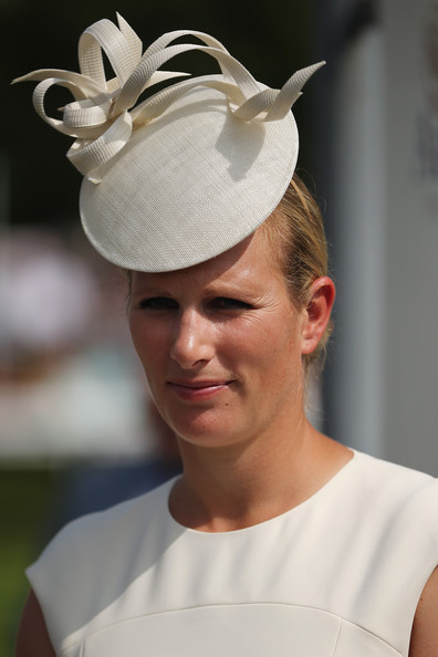 Zara Phillips Zara Philips waits to present a trophy to a rider on Ladies Day at Goodwood Races on July 31, 2014 in Chichester, England. Today is Ladies Day at the prestigious Goodwood Races.
