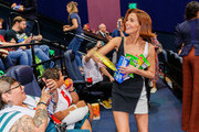 """Actress Zoey Deutch gives snacks to fans at a """"Zombieland 2"""" Panel and Surprise Screening at Los Angeles Convention Center on October 12, 2019 in Los Angeles, California."""