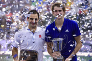 (L-R) Roger Federer of Switzerland and Alexander Zverev of Germany  pose with trophies after an exhibition game between Alexander Zverev and Roger Federer at Arena Parque Roca on November 20, 2019 in Buenos Aires, Argentina.