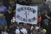 A fan of Roger Federer of Switzerland shows a sign in stands during an exhibition game between Alexander Zverev and Roger Federer at Arena Parque Roca on November 20, 2019 in Buenos Aires, Argentina.