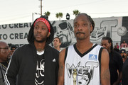 2 Chainz (L) and Snoop Dogg pose with the trophy after the East Vs. West game at adidas Creates 747 Warehouse St., an event in basketball culture, on February 16, 2018 in Los Angeles, California.