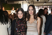 Louise Roe (R) poses during the alice + olivia by Stacey Bendet Fall 2017 Presentation at Highline Stages on February 14, 2017 in New York City.