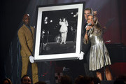 Chairman, Sotheby's West Coast Andrea Fiuczynski speaks onstage during amfAR's Inspiration Gala Los Angeles at Milk Studios on October 29, 2015 in Hollywood, California.