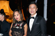 Interior design blogger Aimee Song (L) and CFO at AMTD Philip Yau attend the amfAR Gala Los Angeles 2017 at Ron Burkle's Green Acres Estate on October 13, 2017 in Beverly Hills, California.