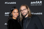 Actress Zoe Saldana and Marco Perego pose during the red carpet of the amfAR gala dinner at the house of collector and museum patron Eugenio López on February 5, 2019 in Mexico City, Mexico.