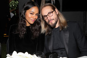 Zoe Saldana and Marco Perego pose during the amfAR gala dinner at the house of collector and museum patron Eugenio López on February 5, 2019 in Mexico City, Mexico.