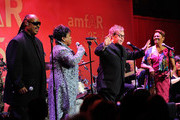 """(L-R) Stevie Wonder, Gladys Knight, Elton John and Dionne Warwick perform """"That's What Friends Are For"""" at the amfAR New York Gala to kick off Fall 2011 Fashion Week at Cipriani Wall Street on February 9, 2011 in New York City."""