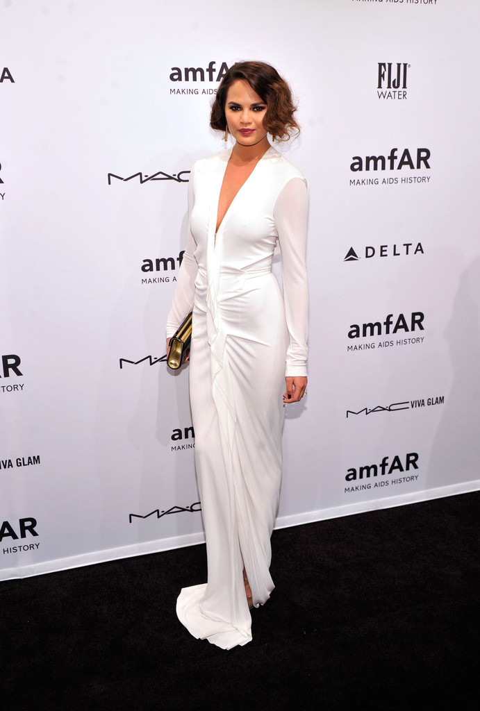 Christine Teigen attends the amfAR New York Gala to kick off Fall 2013 Fashion Week at Cipriani Wall Street on February 6, 2013 in New York City.