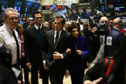 (L-R)  amfAR Ambassador Cheyenne Jackson, amfAR Chairman Kenneth Cole and amfAR ambassador Liza Minnelli walk the trading floor before ringing the opening bell at the New York Stock Exchange in recognition of December 1st's World AIDS Day on November 30, 2010 in New York City.